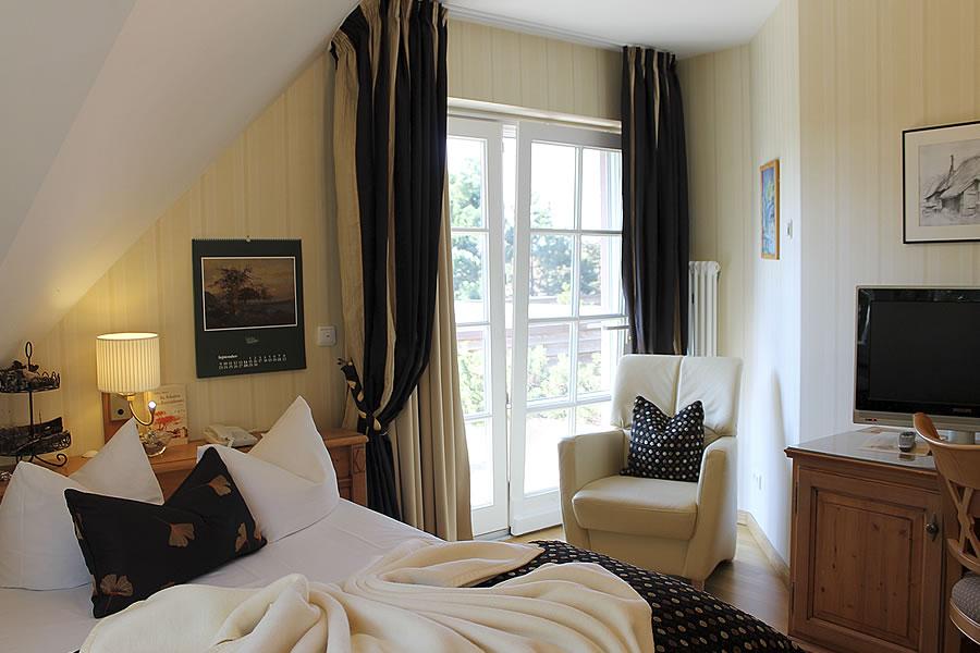 Schlafbereich und gemütliche Lese-Ecke, Einzelzimmer, Beispiel in Hotel Namenlos